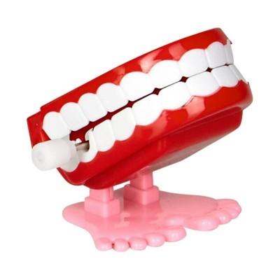 Dentiera saltellante a molla